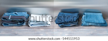 Photo of Denim blue jeans on wooden board. Wide panoramic image.