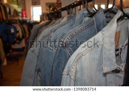 Denim clothes on a clothes rail #1398083714