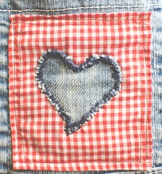 Denim heart on red cloth