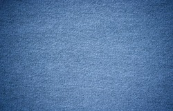 Denim texture in close up view with copy space for vintage background or wallpaper. Blue jeans pattern no seam with macro style to preset about classic fashion cloths concept. Indigo color fabric.