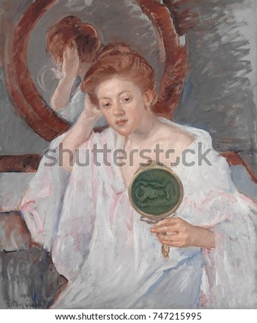 Denise at Her Dressing Table, by Mary Cassatt, 1908-9, French impressionist painting, oil on canvas. An auburn-haired young woman examines her hairdo with two mirrors in a painterly composition of war