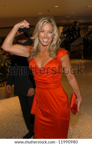 Denise Austin gestures as she arrives at the White House