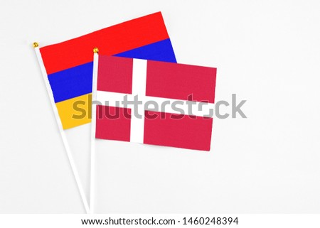 Denmark and Armenia stick flags on white background. High quality fabric, miniature national flag. Peaceful global concept.White floor for copy space. #1460248394