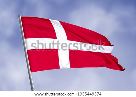 Denmark flag isolated on sky background. close up waving flag of Denmark. flag symbols of Denmark. Foto stock ©