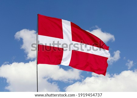 Denmark flag isolated on the blue sky with clipping path. close up waving flag of Denmark. flag symbols of Denmark. Foto stock ©