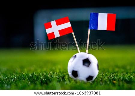 Denmark - France, Group C, Tuesday, 26. June, Football, National Flags on green grass, white football ball on ground. #1063937081
