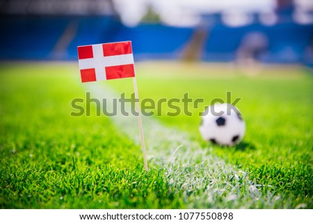 Denmark national Flag and football ball on green grass. Fans, support photo, edit space. Original wallpaper for World cup in Russia 2018. #1077550898