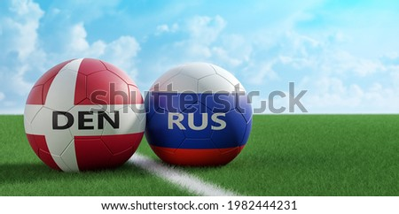 Denmark vs. Russia Soccer Match - Leather balls in Denmark and Russia national colors on a soccer field. Copy space on the right side - 3D Rendering  Foto stock ©