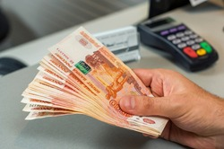 Denominations of five thousand russian rubles. Bundle of banknotes  in male hand.5000 rubles. five thousand cash of the Russian Federation macro Russian currency. Rich concept