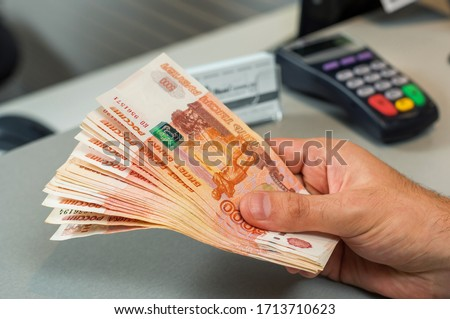 Denominations of five thousand russian rubles. Bundle of banknotes  in male hand.5000 rubles. five thousand cash of the Russian Federation macro Russian currency. Rich concept Stockfoto ©