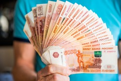 Denominations of five thousand russian rubles. Bundle of banknotes isolated in male hand.5000 rubles. five thousand cash of the Russian Federation macro Russian currency.Rich concept