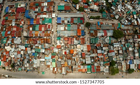 Dense building houses in the slums of Manila top view. Overpopulated poor area.