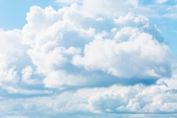 Dense cumulus clouds on a clear blue sky. Space for text. Background.
