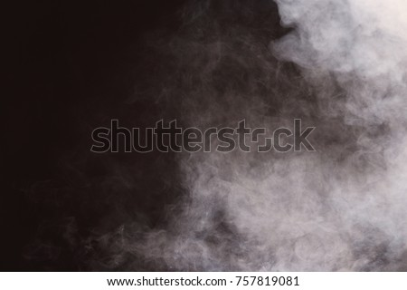 Dense Fluffy Puffs of White Smoke and Fog on Black Background, Abstract Smoke Clouds, All Movement Blurred, intention out of focus, and high low exposure contrast, copy space for text logo