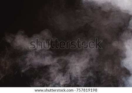 Dense Fluffy Puffs of White Smoke and Fog on Black Background, Abstract Smoke Clouds, All Movement Blurred, intention out of focus, and high low exposure contrast, copy space for text logo #757819198