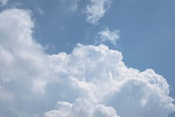 Dense, full-bodied mass of white clouds in a celestial sky, free space for text.