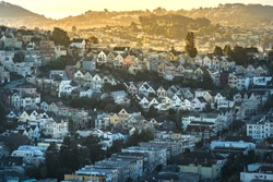 Dense hillside housing in urban San Francisco in the early morning