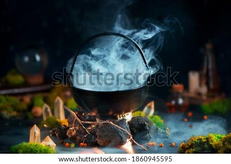 Dense steam above a cauldron, magical still life with smoke, fantasy header Stock photo ©