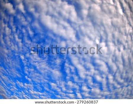 Dense stratus clouds against the blue sky with wide angle fisheye lens and distortion view