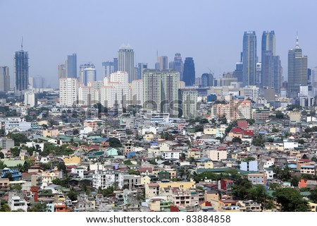 densley populated housing developments crowding high rise condominium ad commercial districts in ortigas and makati manila the philippines
