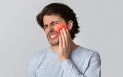 Dental care and health concept. Despaired man endure pain, empty space