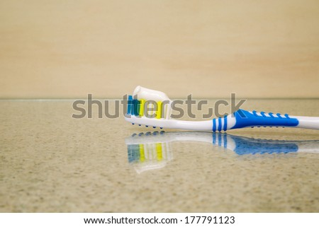 Dental care equipment, toothbrush with toothpaste on glass