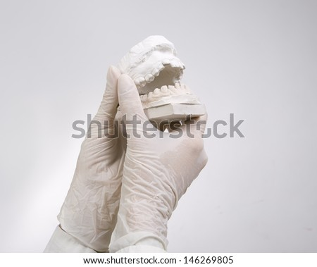 Dental Casting - hands holding dental gypsum models, dental concept