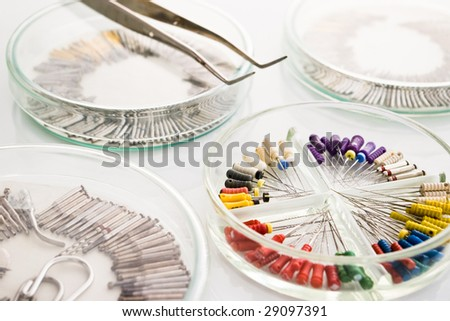dental tools with drills and tweezers - stock photo