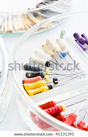 dental tools with drills on glass plate