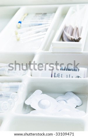 dental tools with pills and needles