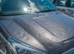 Dented car after a big hail storm