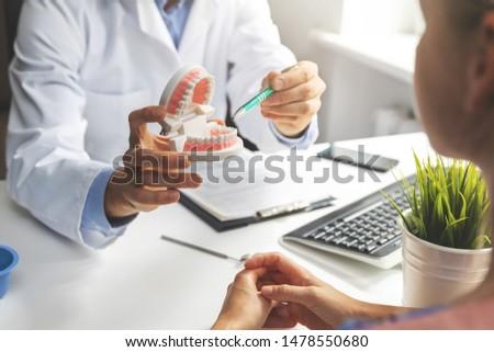 dentist consultation - patient visit at dental clinics office