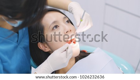 Dentist examining a patient teeth in the dentist
