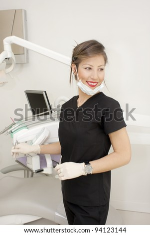 Dentist in her office posing to cam