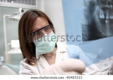 Dentist looking at the x ray