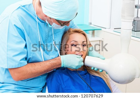 Dentist make jaw x-ray image for girl in dental clinic