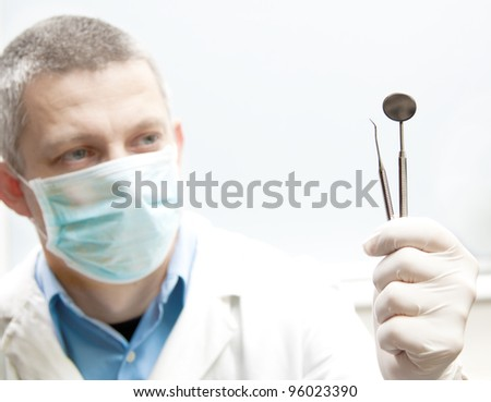 dentist tools in a doctor hand