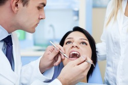 dentist working with patient.