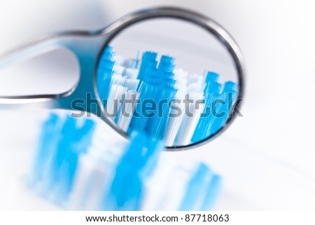 dentistry mirrow and toothbrush