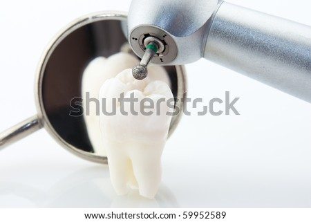 Dentistry. Wisdom tooth dental mirror and machine with drill