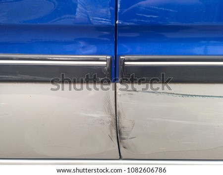 Dents and scratches on a car #1082606786