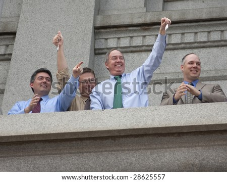 DENVER - APRIL 15: Members of Colorado's House, Senate and Aides hold up tea bags during the Tea Party at the Colorado Capitol, April 15, 2009 in Denver.