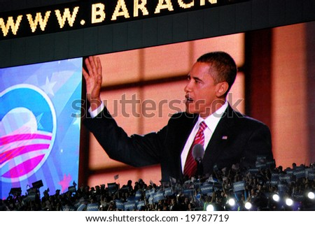 DENVER - AUG 28: Democratic presidential candidate Barack Obama speaking at Invesco Field at Mile High Stadium in Denver, Colorado, on August 28, 2008, reflected on screen.