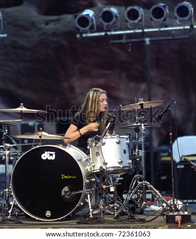 DENVER - AUGUST 28:		Drummer Martina Axen of the all female Heavy Metal band Drain STH performs in concert August 28, 1998 at Red Rocks Amphitheater in Denver, CO. - stock photo