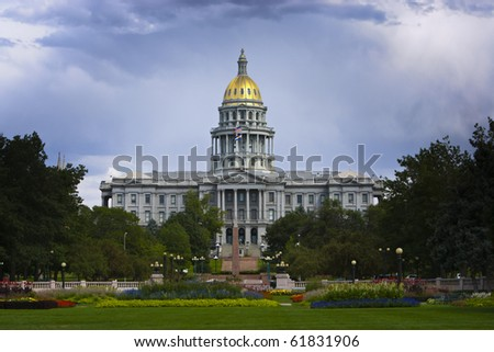Denver Capitol in Summer. Dark blue sky behind brightly lit gold domed capitol