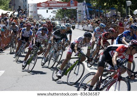 DENVER, CO - AUG 28: Professional cyclists maneuvering through a tight turn at the 2011 USA Pro Cycling Challenge in Denver, Colorado on Aug 28, 2011