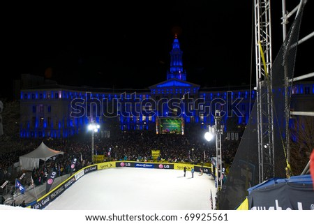 DENVER, CO - JAN 26: Snowboarders at the LG FIS World Cup Snowboard Big Air competition flew off a 300 foot ramp toward the Denver City and County Building January 26, 2011 in Denver, CO.