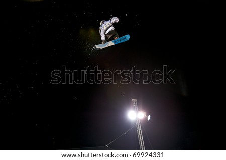 DENVER, CO - JAN 26: Unidentified Participant in the LG FIS World Cup Snowboard Big Air competition which drew an international roster of the top male snowboarders from around the globe January 26, 2011 in Denver, CO.