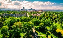 Denver Colorado green trees cover landscape east of Downtown Denver aerial drone view of Colorado Summer