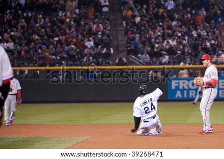 DENVER, COLORADO - OCTOBER 11: Dexter Fowler slides safely into second base in game 3 of the Rockies, Phillies National League Division Series on October 11, 2009 in Denver Colorado.